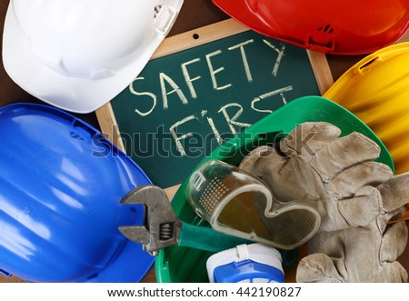 color helmets and board with the inscription SAFETY FIRST