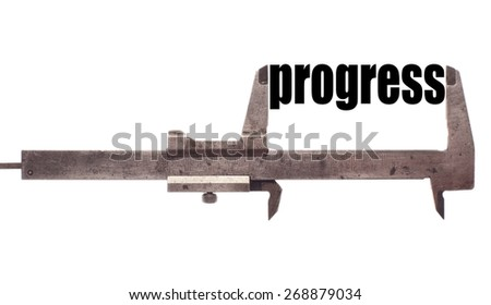 "Color horizontal shot of a caliper and measuring the word ""progress"". - stock photo"