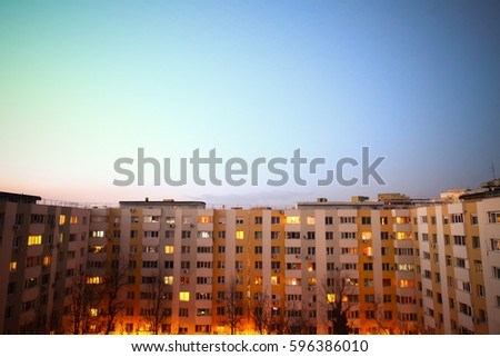 Color imae of some flats in a block, at sunset.