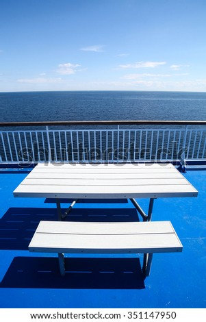 Color image of a rail on the deck of a cruise ship. - stock photo