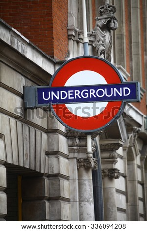 Color image of an underground subway sign in London, UK. - stock photo