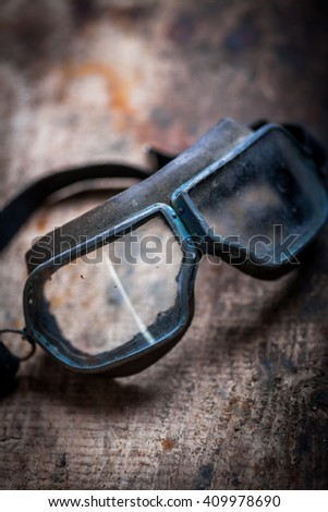 Color image of some old used goggles. - stock photo