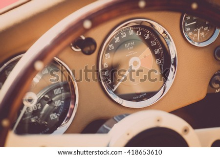 Color image of the dashboard of a retro car. - stock photo