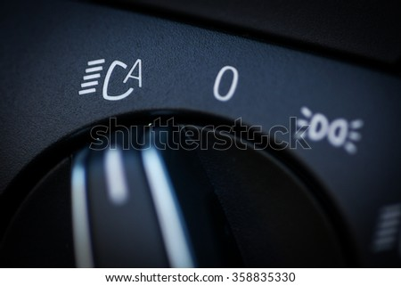 Color image of the headlights switch in a car.