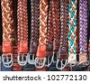 Color leather belts in store - stock photo