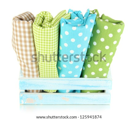 Color mottled fabrics in basket isolated on white - stock photo