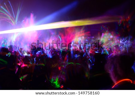 Color neon streaks of light glow sticks at a night celebration and rave - stock photo