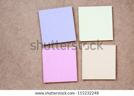 Color note paper on textured background