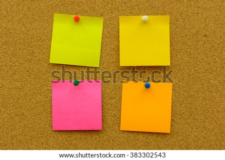 Color note paper with color pin on the cork board