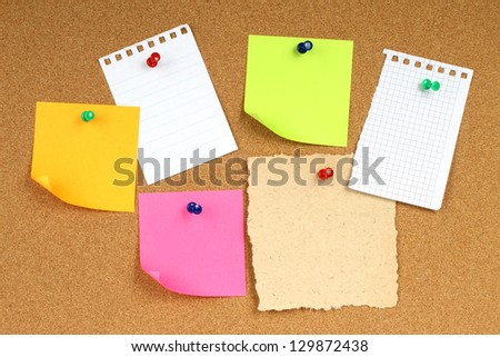 Color notes papers on wooden background