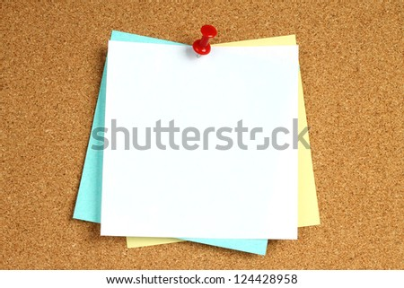 Color notes with pin on wooden background - stock photo