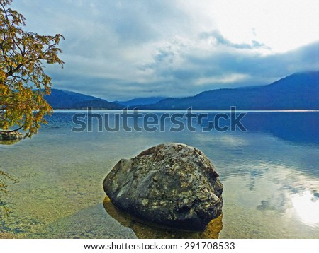 Color Painting Beautiful Scenery Calm and Tranquil View at Lake Bohinj, Slovenia after Storm on Sandstone Texture