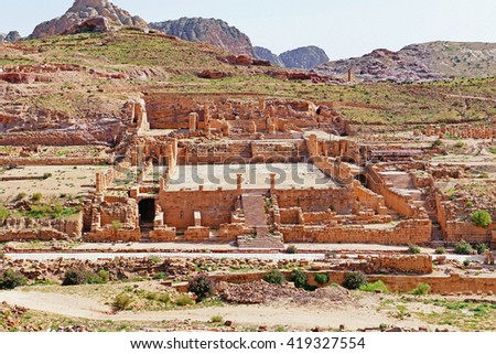 Color Painting Scenic View Ruins of The Great Temple in Petra, Jordan on Sandstone Texture - stock photo