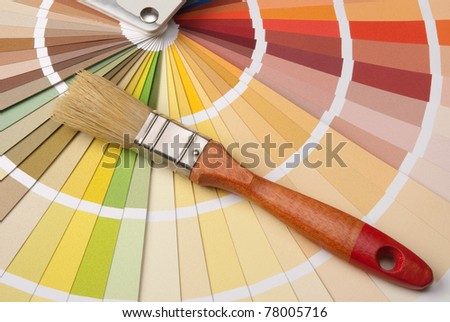 Color palette and a brush - stock photo