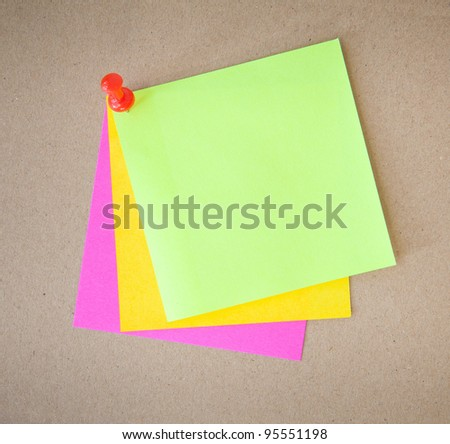 color paper and pin on wood texture background