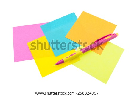 Color paper note and pen on isolated white background