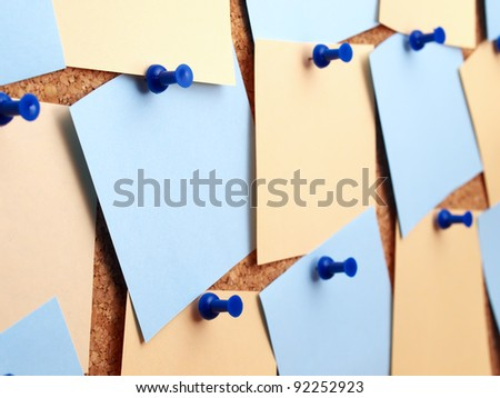 Color paper on board for notes. Office subjects - stock photo