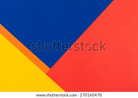 color papers geometry flat composition background with yellow orange red and blue tones