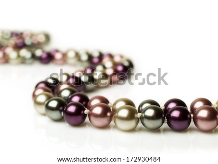 color pearl necklace isolated on white - stock photo