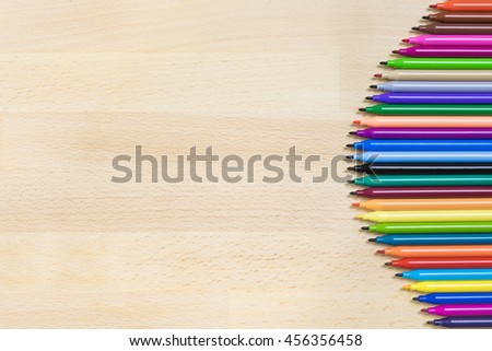 Color Pen on Light Brown Wood Desk or Table Background and Wallpaper Copy Space in The Left Side , View from Top or Above - stock photo