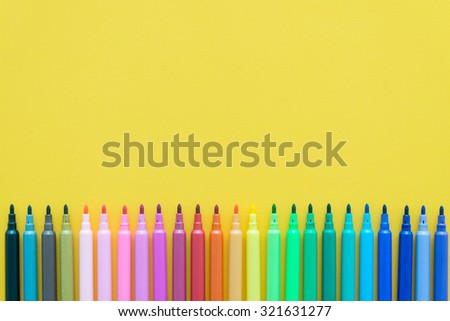 Color pen on yellow paper background