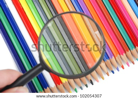 Color pencil and magnifying glass