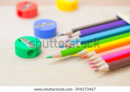 color pencil on wood background, colorful kids school artist concept.