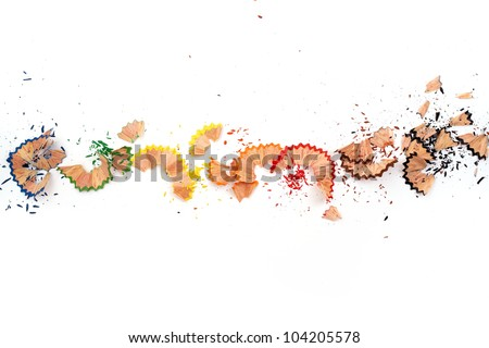 Color pencil shaves in line on a white paper - stock photo