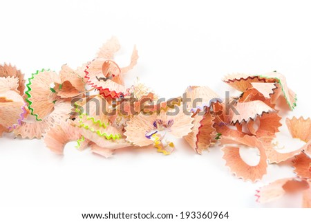 Color pencil shaves on white background - stock photo