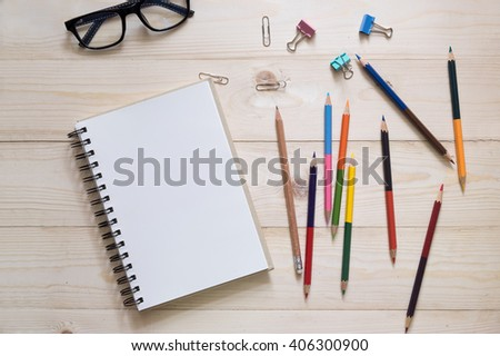 Color Pencil using a sharpener on wooden table - stock photo