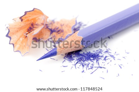 Color pencill with sharpening shavings on white background - stock photo