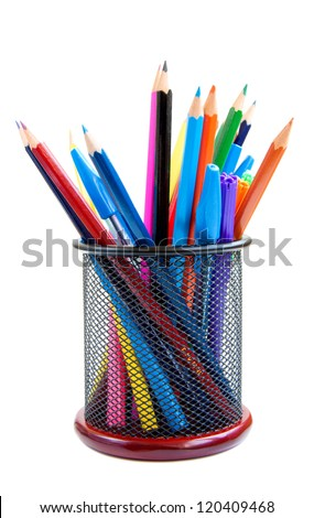 Color pencils and pens in  metal vase on a white background - stock photo