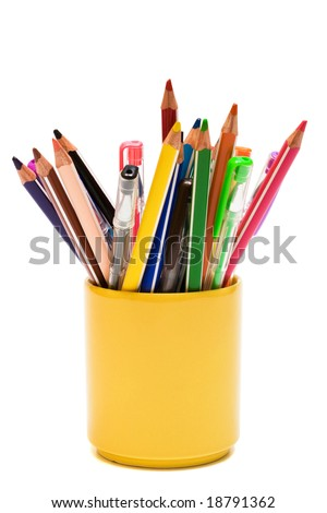 Color pencils and pens on a white background - stock photo