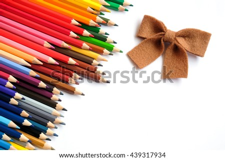 Color pencils  and ribbon isolated on white background close up with copy space - stock photo