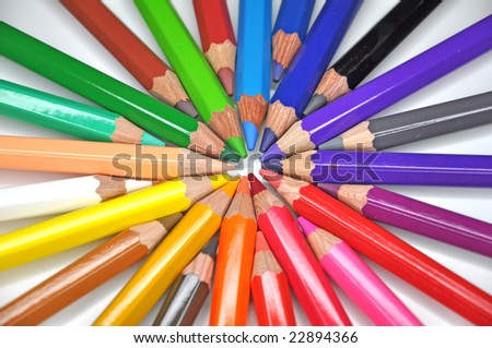 Color pencils arrange in a wheel colors isolated on white - stock photo
