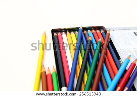 Color pencils box isolated over white background close up