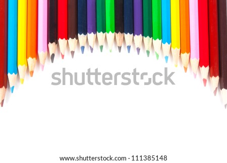 Color pencils combined to the smooth line isolated on a white background