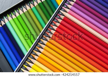 Color pencils, crayons in rows, background