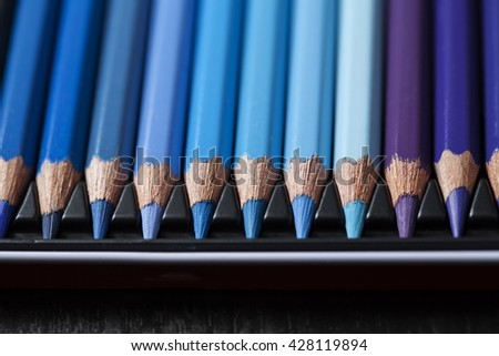 Color pencils, crayons in rows, blue shades, background