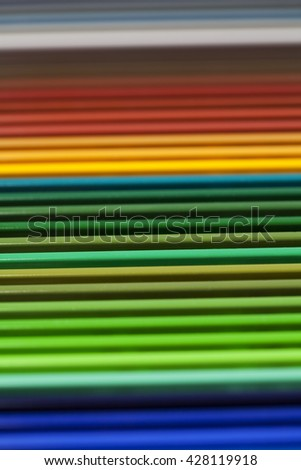 Color pencils, crayons in rows, green shades, background