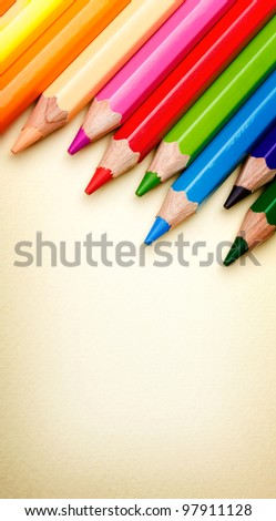 Color pencils crayons on paper background - stock photo