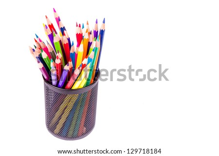 Color pencils in an office stand isolated on white - stock photo