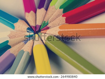 Color pencils in circle with a vintage effect. - stock photo