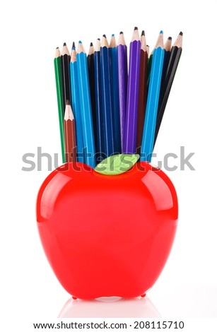 color pencils in red apple shaped stand isolated on white - stock photo