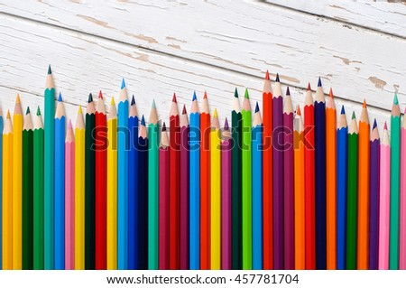 Color pencils isolated on wooden background.Close up. - stock photo