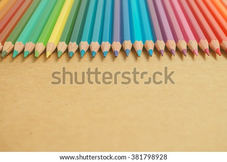 color pencils on craft paper background