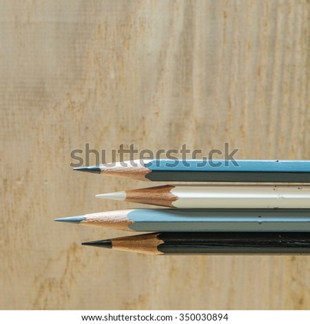 Color pencils on wood background
