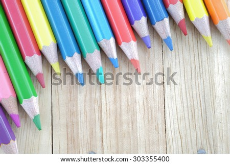 Color pencils on wood table vintage color style - stock photo