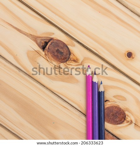 color pencils on wooden background