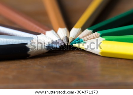 Color pencils on wooden table. Macro with extreamely depth of field